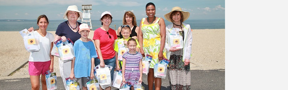 Members hit local beach to educate the community about skin cancer risks